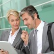 Business team meeting outside with tablet — Stock Photo