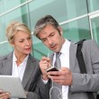 Business team meeting outside with tablet — Stock Photo #13943445