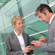 Stock Photo: Business exchanging phone numbers