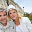 Happy couple doing shopping in town — Stock Photo