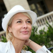 Portrait of beautiful middle-aged woman wearing hat — Stock Photo #13943514