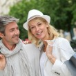 Happy couple doing shopping in town — Stock Photo #13943515