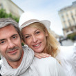 Happy couple doing shopping in town — Stock Photo #13943535