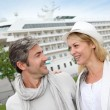 Happy romantic couple standing in front of cruise boat — Stock Photo #13943572