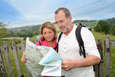 Retired reading map on trekking day — Stock Photo