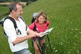Retired reading map on trekking day — Stock Photo