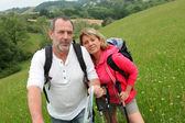 Closeup of senior couple on a rambling day — Stock Photo