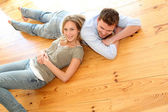 Couple at home relaxing on the floor — Stok fotoğraf