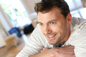 Portrait of handsome guy with blue eyes — Stock Photo