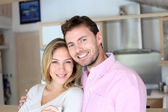 Portrait of in love couple standing in home kitchen — Stock Photo