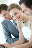 Businesswoman attending meeting with colleagues — Stock Photo
