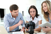 Team of photo reporters working in office — Stok fotoğraf
