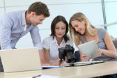 Team of photo reporters working in office — Stock Photo
