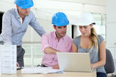 Team of architects working in office — Stock Photo