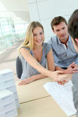 Couple shaking hand to real-estate agent in office — Stock Photo