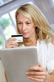 Blond mature woman doing online shopping — Stock Photo