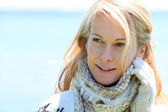 Portrait of middle-aged woman in winter at the beach — Stock Photo