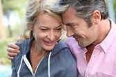 Portrait of middle aged couple looking at each other — Stock Photo