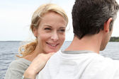 Happy woman relaxing on husband's shoulder — Stock Photo