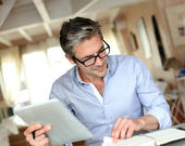 Handsome businessman with eyeglasses working from home — Stok fotoğraf