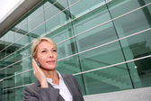 Close up of middle aged woman talking on cellphone — Stock Photo