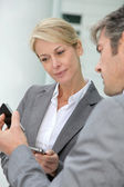 Business exchanging phone numbers — Stock Photo