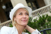Portrait of beautiful middle-aged woman wearing hat — Stock Photo