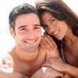 Stock Photo: Portrait of romantic couple laying on the beach