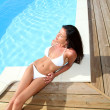 Glamourous woman relaxing by swimming-pool — Stock Photo #13956888