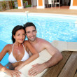 Young smiling couple bathing in private pool — Stock Photo