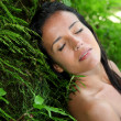 Attractive young woman in natural vegetation - Stock Photo