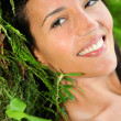 Stock Photo: Attractive young woman in natural vegetation