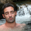 Closeup of man relaxing in natural river spa — Stock Photo