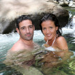 Closeup of cheerful couple bathing in river — Stock Photo
