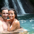 Stock Photo: Happy couple bathing near waterfall in island