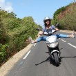 Young woman riding motorbike — Stock Photo