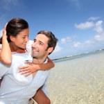 Lovers enjoying sunny day at the beach — Stock Photo