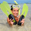 Closeup of smiling woman with diving mask and flippers - Stock Photo