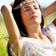 Gypsy girl with neacklace around her head — Stock Photo #13957144