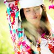 Beautiful gypsy girl with scarf standing in meadow — Stock Photo
