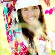 Beautiful gypsy girl with scarf standing in meadow — Stock Photo #13957153