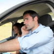 Stock Photo: Mtalking on mobilephone while driving