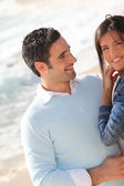 Romantic couple walking by the beach — Stock Photo