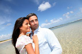 Couple of lovers embracing each other at the beach — Stock Photo