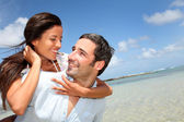 Lovers enjoying sunny day at the beach — Stock Photo