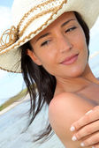 Closeup of woman with pareo standing on the beach — Stock Photo