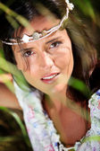 Gypsy girl with neacklace around her head — Stock Photo