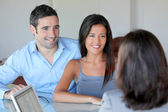 Couple meeting financial adviser for investment — Foto de Stock