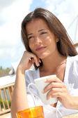 Portrait of beautiful young woman having breakfast — Stock Photo
