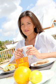Portrait of beautiful young woman having breakfast — Stock Photo